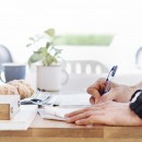 Man Writing Document Dinning Table Concept